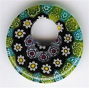 Many discs of millfiori are fused to create this pendant.