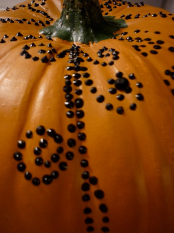 Dotted Swirls with puff paint give this pumpkin a henna design - ThinkCrafts.com