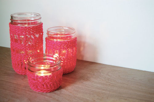 Use neon cord to crochet these fun jar cozies. Pattern at ThinkCrafts.com