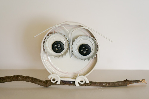 Create this cute owl with recycled materials! Tutorial at ThinkCrafts.com