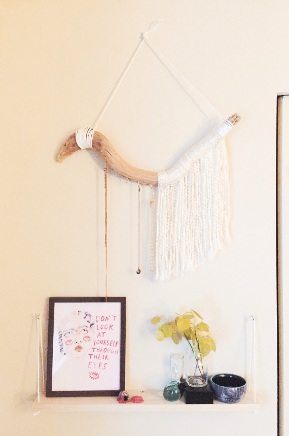 Display your jewelry on a pretty art piece with this DIY Necklace Hanger