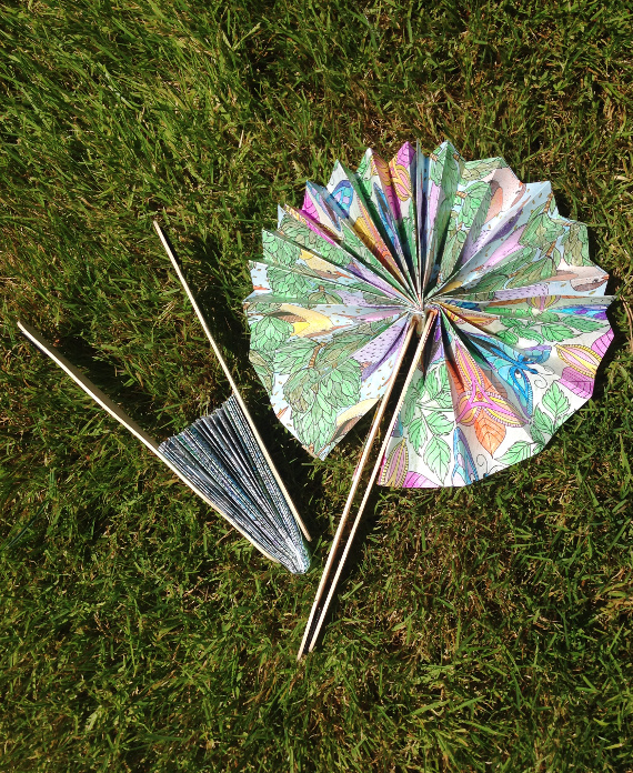 Beat the heat and find a use for your coloring pages with a fun and colorful fan craft!
