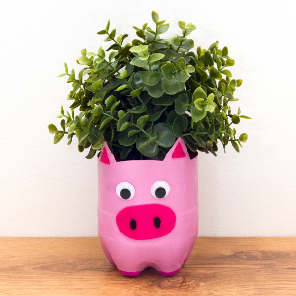 Upcycle an old plastic bottle into an adorable pig planter!