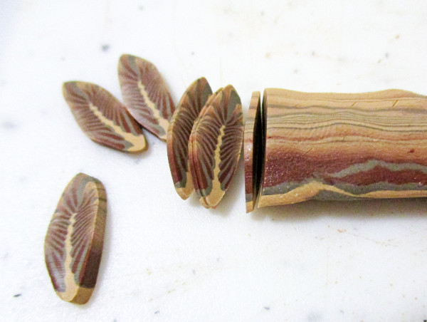 Learn to make a cane that looks like a feather when cut. Perfect for boho jewelry!