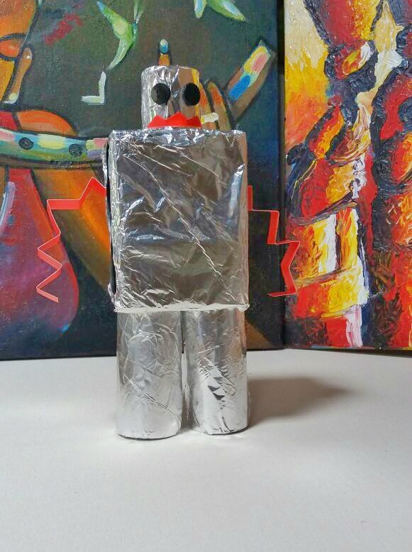 DIY robot from recycled materials - perfect rainy day kids craft!