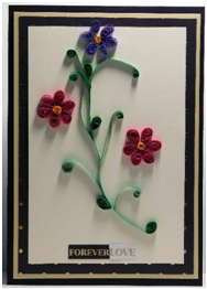 Make a quilled card for a happy couple.